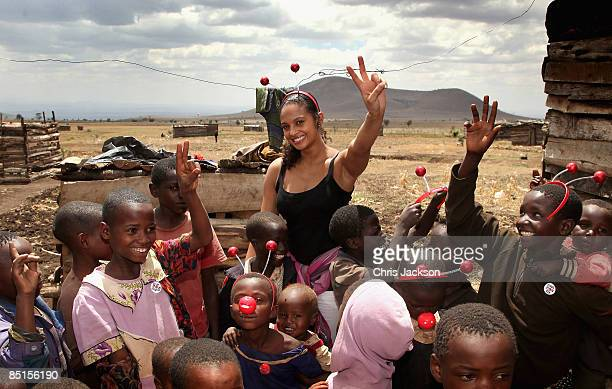 Singer Alesha Dixon meets children in Ngare Naiyobi village with Kilimanjaro District nurse Hossiana Myusa on February 27 2009 in Moshi Tanzania The...