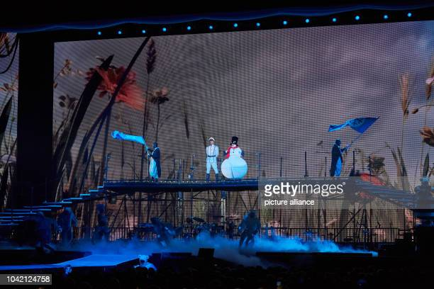 Singer Alex Wesselsky from the band Eisbrecher as Eisgeneral and Heinz Hoenig as Arktos on stage during the premiere of Peter Maffay's rock fairytale...