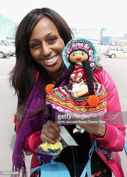 Singer Alexandra Burke holds up a traditional Peruvian doll she bought as she arrives at Cusco Airport ahead of Denise and Fearne's Charity Trek for...
