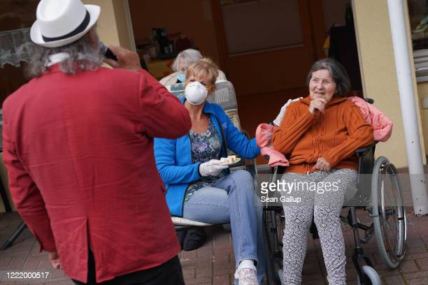 Singer Alf Weiss performs live as residents including Marlene Schulz and caregiver Marine Lehmberg look on at the Hermann Radtke Haus nursing home...