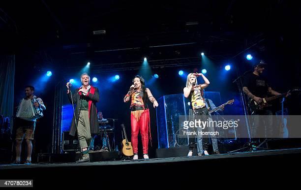 Singer Alfred Fred Jaklitsch Sabine Sassy Holzinger and Astrid Wirtenberger of the Austrian band Die Seer perform live during a concert at the...