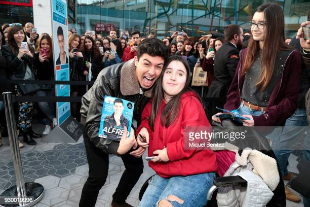 Singer Alfred Garcia 'Alfred' from OT Operacion Triunfo poses with a fan during the Sings Copies of His New Album at Glories Centre Comercial on...
