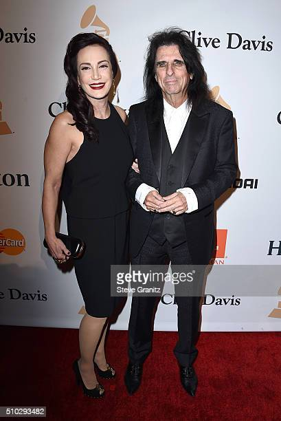 Singer Alice Cooper and Sheryl Goddard attend the 2016 PreGRAMMY Gala and Salute to Industry Icons honoring Irving Azoff at The Beverly Hilton Hotel...