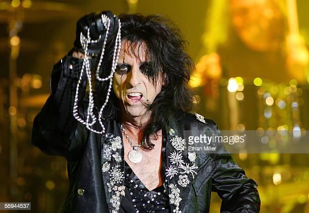 Singer Alice Cooper tosses beads to the audience as he performs during a sold out show at the Joint inside the Hard Rock Hotel Casino October 17 2005...