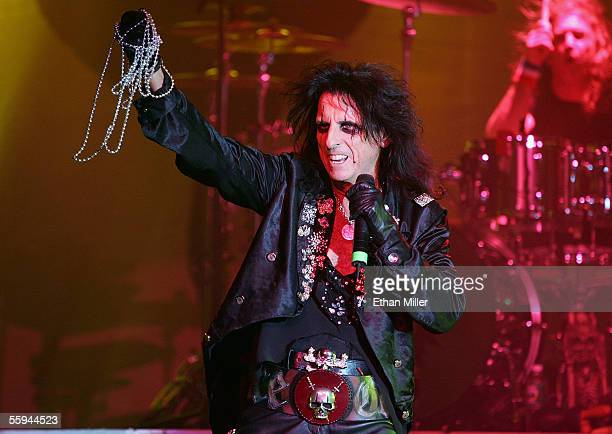 Singer Alice Cooper tosses beads to the audience as he performs with drummer Eric Singer during their sold out show at the Joint inside the Hard Rock...