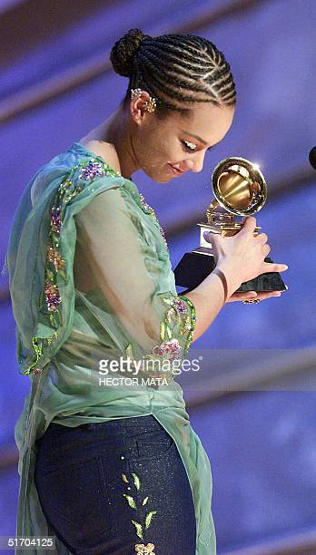 Singer Alicia Keys accepts her Grammy for Best RB Album for 'Songs in a Minor' at the 44th Annual Grammy Awards in Los Angeles 27 February 2002 AFP...