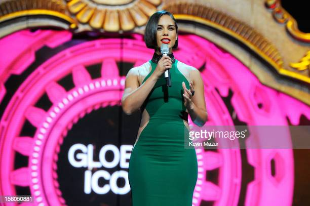 Singer Alicia Keys accepts the Global Icon award on behalf of Whitney Houston during the MTV EMA's 2012 at Festhalle Frankfurt on November 11 2012 in...