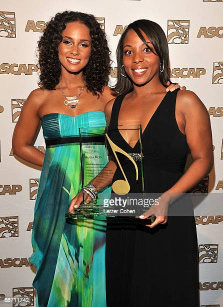 Singer Alicia Keys and ASCAP assistant vice president Nicole George pose in the press room during the 22nd annual ASCAP Rhythm and Soul Awards held...