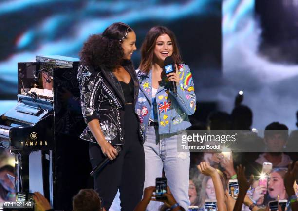 Singer Alicia Keys and host of WE Day California actress/singer and UNICEF Goodwill Ambassador Selena Gomez onstage at WE Day California to celebrate...