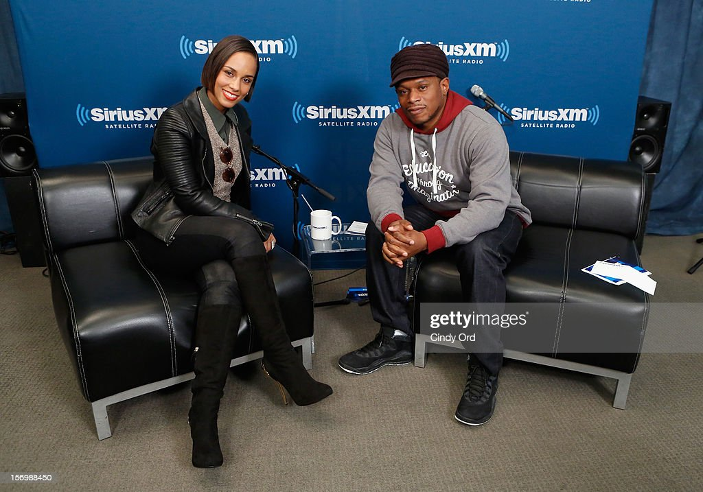 Singer Alicia Keys and SiriusXM host Sway Calloway pose during the SiriusXM Town Hall With Alicia Keys And Moderator Sway Calloway Live On 'Heart And Soul' at SiriusXM Studios on November 26, 2012 in New York City.