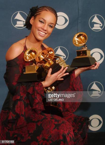 Singer Alicia Keys hold five of her Grammys at the 44th Annual Grammy Awards at the Staples Center in Los Angeles, 27 February 2002. Keys won her...