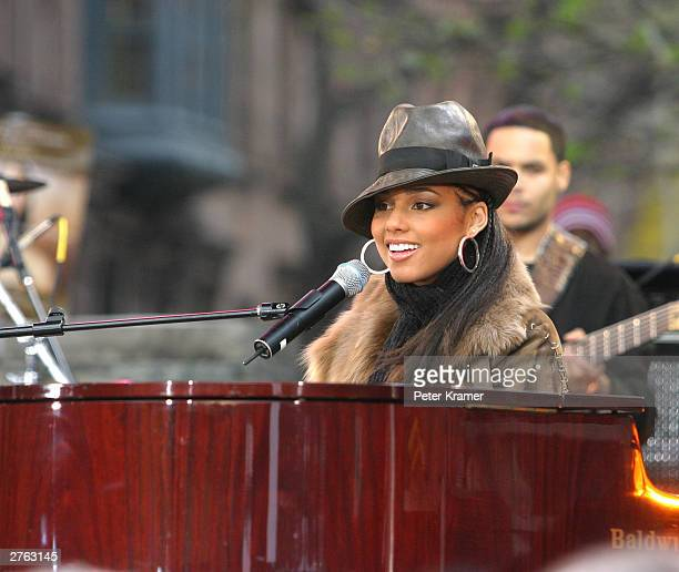 Singer Alicia Keys performs on Good Morning America in Marcus Garvey Park in Harlem to promote her new album The Diary of Alicia Keys on November 26...