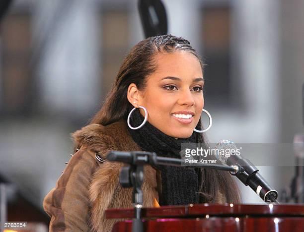 Singer Alicia Keys performs on Good Morning America in Marcus Garvey Park in Harlem to promote her new album The Diary of Alicia Keys on November 26...
