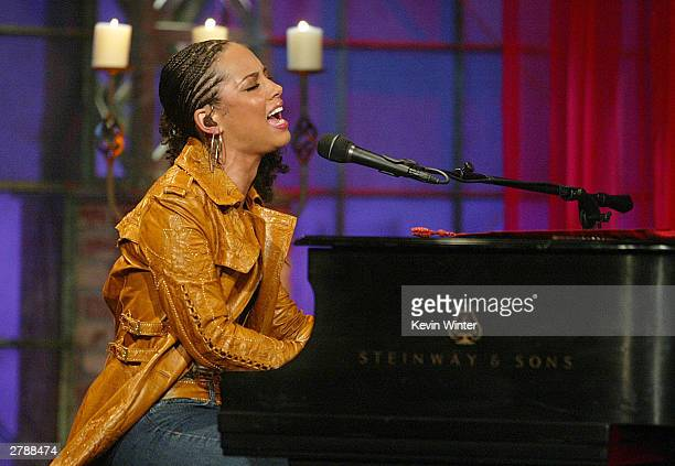 Singer Alicia Keys performs on The Tonight Show with Jay Leno at the NBC Studios on December 5 2003 in Burbank California