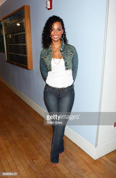 Singer Alicia Keys poses for a photo backstage during MTV's Total Request Live at the MTV Times Square Studios October 11 2005 in New York City
