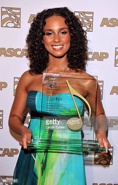 Singer Alicia Keys poses in the press room with the Golden Note award during the 22nd annual ASCAP Rhythm and Soul Awards held at The Beverly Hilton...