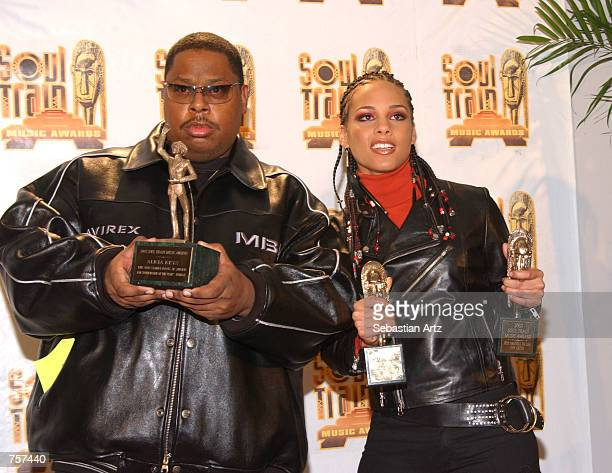 Singer Alicia Keys poses with her manager Jeff in the press room at the Soul Train Music Awards March 20 2002 in Los Angeles CA