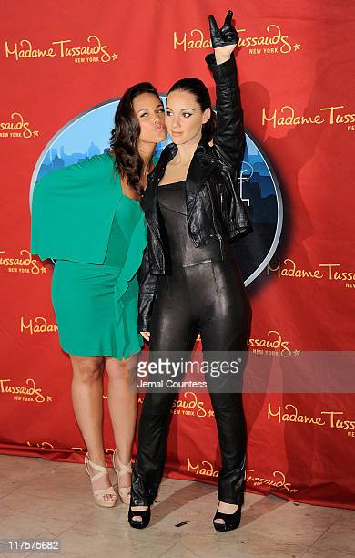 Singer Alicia Keys poses with her wax figure during the Alicia Keys Wax Figure Unveiling at Madame Tussauds on June 28 2011 in New York City