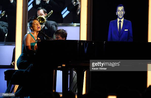 Singer Alicia Keys sings with a hologram of Frank Sinatra onstage during the 50th annual Grammy awards held at the Staples Center on February 10 2008...