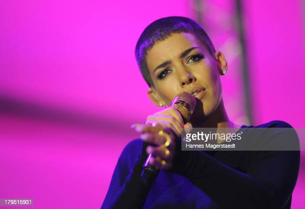 Singer Alina Sueggeler of Frida Gold performs during the Universal Channel launch party at Brienner Forum on September 4 2013 in Munich Germany