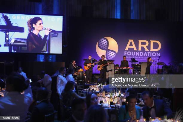 Singer Aline Muniz performs on stage during the Alcides Rosaura Foundations' 'A Brazilian Night' to Benefit Memorial Sloan Kettering Cancer Center at...