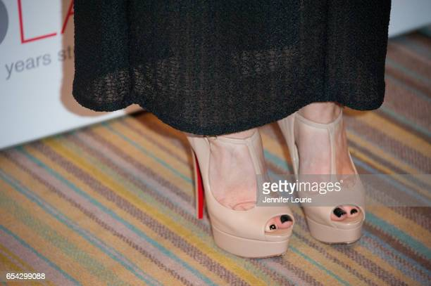 """Singer Alisan Porter, shoe detail, attends the American Red Cross Centennial Celebration to Honor Disney as the """"Humanitarian Company of The Year"""" at..."""