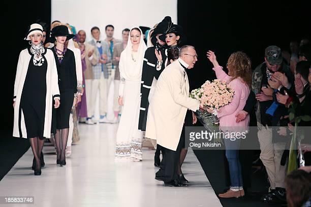 Singer Alla Pugacheva greets desginer Slava Zaitsev at the end of the SLAVA ZAITSEV For Ufa Knitwear LLCTM 'TRICARDO' show during the MercedesBenz...