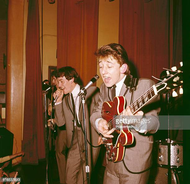 Singer Allan Clarke and guitarist Tony Hicks from English pop group The Hollies perform live on stage in 1964