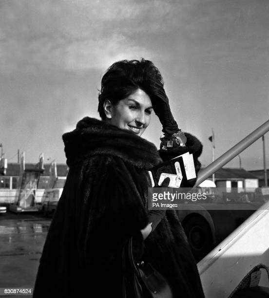 Singer Alma Cogan combating the weather with a luxurious fur coat leaves London airport for New York