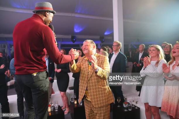 Singer Aloe Blacc performes with Manfred Dirrheimer CEO of FWU at the FWU Night 2018 on day 8 of the BMW Open by FWU at MTTC IPHITOS on May 5 2018 in...