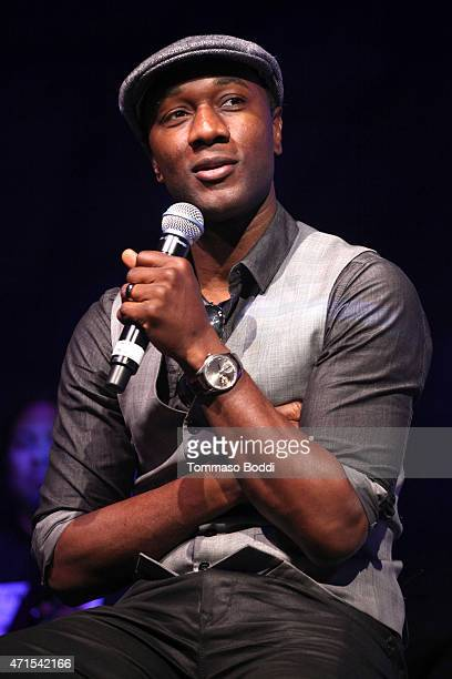 Singer Aloe Blacc performs on stage at the GUESS Foundation and Peace Over Violence host 2015 Denim Day celebration at GUESS Headquarters on April 29...