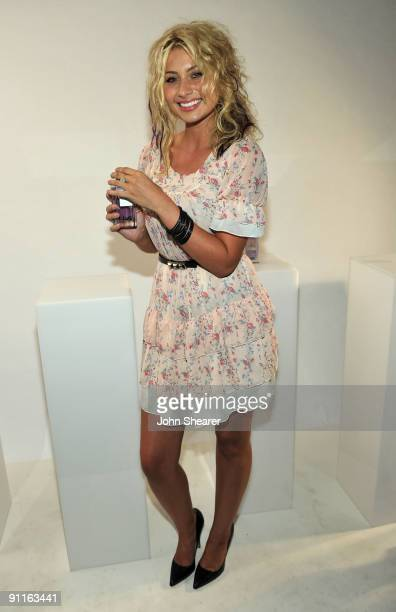 Singer Aly Michalka poses with the DG fragrance bar during the 7th Annual Teen Vogue Young Hollywood Party held at Milk Studios on September 25 2009...
