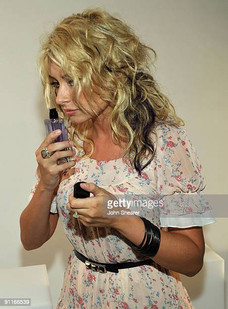 HOLLYWOOD SEPTEMBER 25 Singer Aly Michalka poses with the DG fragrance bar during the 7th Annual Teen Vogue Young Hollywood Party held at Milk...
