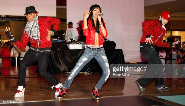 Singer Alycia Bellamy performs with dancers during a concert and fashion show for Vanessa Simmons and Angela Simmons' Pastry handbag and apparel line...