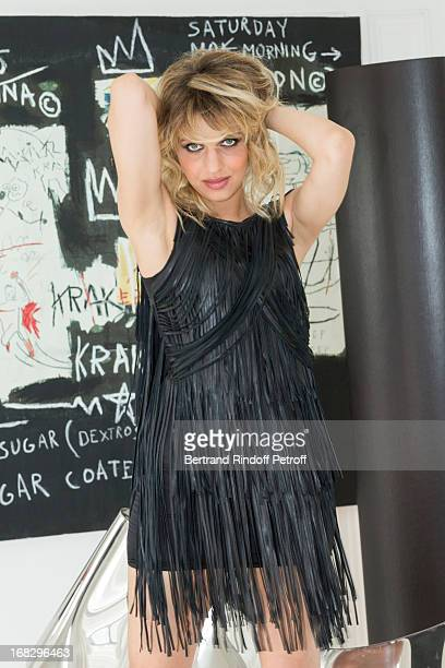 Singer Amandine Bourgeois poses with a dress designed by fashion designer JeanClaude Jitrois in Jitrois' appartment following a tryingon session on...