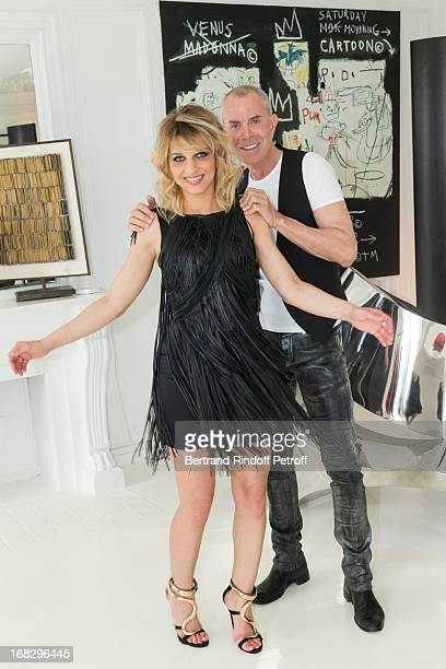 Singer Amandine Bourgeois wearing a dress designed by fashion designer JeanClaude Jitrois and Jitrois pose in Jitrois' appartment following a...