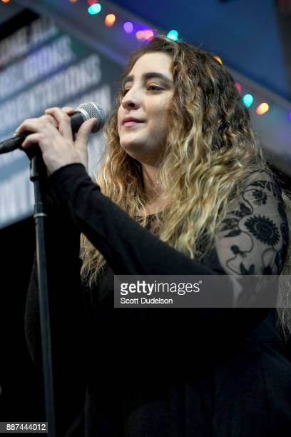 Singer Ambha Love performs as a special guest during Mike Love's performance at Amoeba Music on December 6 2017 in Hollywood California