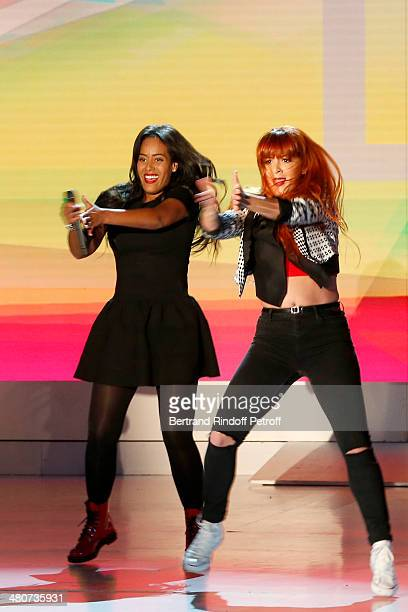 Singer Amel Bent and a dancer perform on stage during the recording of television show host's Michel Drucker's 'Vivement Dimanche' weekly show at...