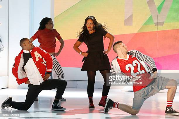 Singer Amel Bent and dancers performs on stage during the recording of television show host's Michel Drucker's 'Vivement Dimanche' weekly show at...