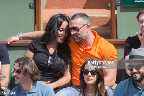 Singer Amel Bent and her companion attend the Roland Garros French Tennis Open 2014 Day 12 at Roland Garros on June 5 2014 in Paris France