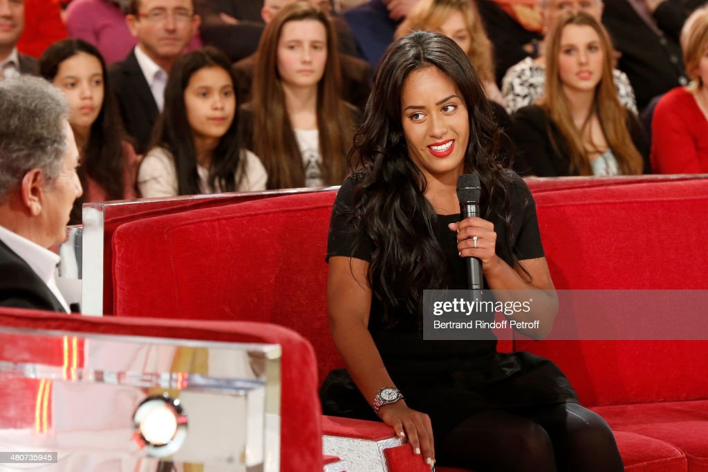 Singer Amel Bent (R) talks with show host Michel Drucker (L) during the recording of Drucker's 'Vivement Dimanche' weekly show at Pavillon Gabriel on March 26, 2014 in Paris, France.