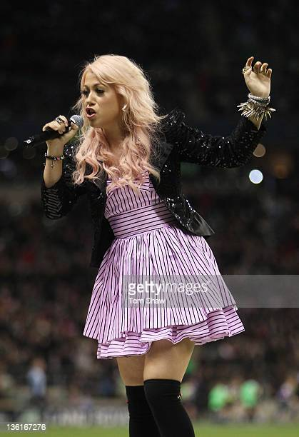 Singer Amelia Lily performs during the Aviva Premiership match between Harlequins and Saracens at Twickenham Stadium on December 27 2011 in London...