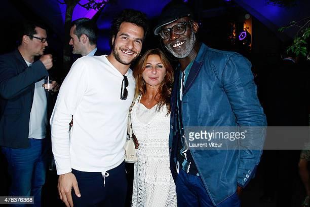 Singer Amir Hairdresser Sarah Guetta and Actor Eriq Ebouaney attend the Hublot Blue Coktail at Mr Bleu at Palais de Tokyo on June 24 2015 in Paris...