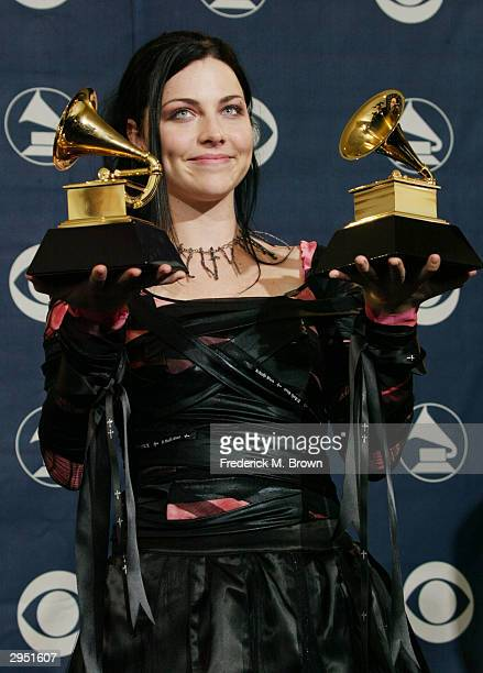 Singer Amy Lee of Evanescence poses backstage in the Pressroom at the 46th Annual Grammy Awards held at the Staples Center on February 8 2004 in Los...