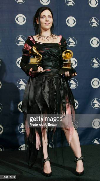 Singer Amy Lee of Evanescence poses with her two Grammys backstage in the Pressroom at the 46th Annual Grammy Awards held at the Staples Center on...