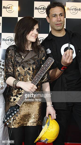 Singer Amy Macdonald and singer 'Evil' Jared Hennagan attend the Hard Rock Cafe Berlin reopening on April 28 2010 in Berlin Germany
