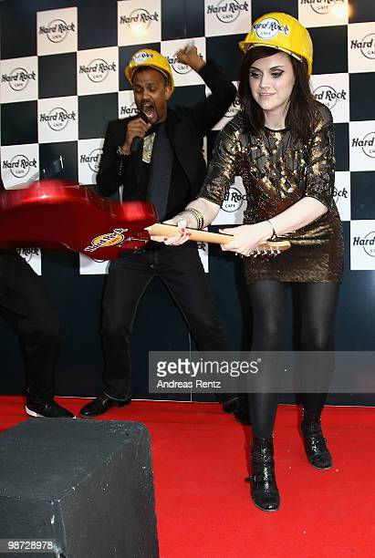 Singer Amy Macdonald smashes a guitar at the Hard Rock Cafe Berlin reopening on April 28 2010 in Berlin Germany