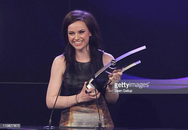 UK singer Amy Macdonald speaks after receiving her Female Artist International Rock/Pop Award at the Echo Awards 2011 at Palais am Funkturm on March...
