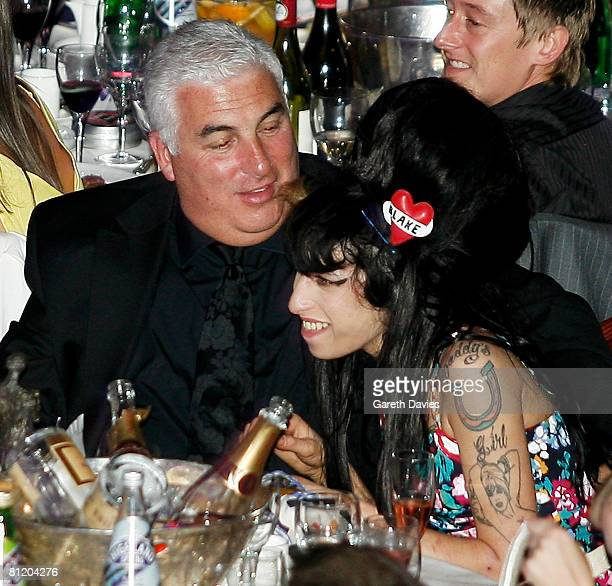 Singer Amy Winehouse and her father Mitch attend the 53rd Ivor Novello Awards at the Grosvenor House Hotel on May 22 2008 in London England