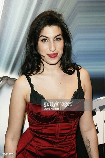 Singer Amy Winehouse arrives at the announcement of the shortlist for The Brit Awards 2004 at the Park Lane Hotel on January 12 2004 in London The...